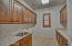 Now this is a laundry room! Adjacent to this is huge floor-to-ceiling cabinetry housing a huge pantry area!