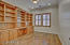 Den shows off plenty of built-in cabinetry and space for your office accessories
