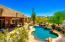 Enjoy the serene resort style backyard with privacy on 2.45 acres and mountain views.