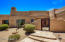 Welcome home to this custom southwest territorial complete with private courtyard.