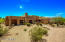 Custom southwest territorial on 2.45 acres features low maintenance desert landscaping and a circle paver drive.
