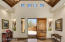 """Foyer features vaulted tongue and groom ceiling, clearastory windows and 18"""" tumbled travertine flooring and 4"""" baseboards."""