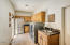 Laundry room offers lots of storage and granite counter tops. Refrigerator, washer and dryer do not convey.