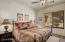 Spacious secondary bedroom is ensuite and enjoys views of the front courtyard.