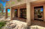 Detached guest casita is 741 sq ft and offers a living room, kitchenette, bedroom and bathroom.
