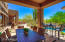 Spacious covered patio allows for numerous entertaining areas.