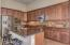 Large kitchen with a abundance of cabinets, gas cooktop, double ovens, micro, frig and breakfast island