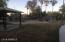 Back ground, picnic area, and gated pool.