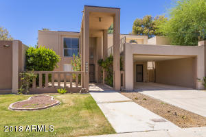 The home sits on a quiet street across the street from the heated community pool & spa making it the perfect location within the community of Sands Scottsdale.