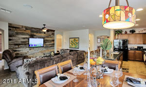 Family/Great room has built-in speakers & a custom reclaimed wood accent/entertainment wall.