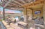 Covered patio with an extended pergola & tile pavers that expands and connects the outdoor living space beyond the covered patio.