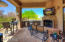 The covered patio off the family room offers a gas fireplace, sitting area and BBQ space.