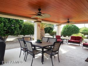 Wow! What a wonderful place to spend many hours enjoying your gorgeous extended covered patio and lush backyard with nature landscaping