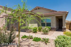 Built 2016. Low utility bills! Desert landscape with extended covered front porch.