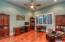 This room with hardwood flooring could be an office, study or bedroom as it has its own closet!