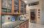 Fantastic wetbar with glass shelving and a Viking 150 bottle stainless steel wine refrigerator!