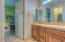 Shared bath with travertine on all countertops!