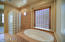 Looking toward shower and tub in master bath room.