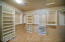 Huge walk-in master closest with built in shelves, and hanging space.