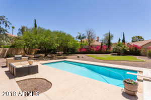 Ready for a pool party! Time to BBQ, swim, play and gather around the conversation area under the shade.