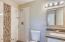 TOTALLY REDONE BATHROOMS WITH J&K CABINETS MATCHING THE KITCHEN