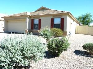 This amazing home is on a corner lot 5 minutes away from I-10 and Loop 303.