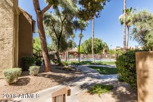 End Unit directly in front of the pool & tennis court and across from the fitness center.