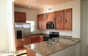 Slab Granite Counters & Stainless Appliances