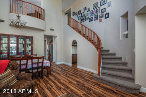 beautiful curving staircase and juliet balcony. Check out the wine room under the stairs!