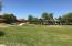 Large greenbelt with walking trail and covered play and picnic area.