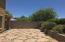 Backyard includes flagstone, raised planter, covered patio and adjoins HOA Common Area.