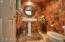 Powder room with pedestal sink and custom mirror and great artistic paint!