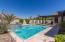 Sparkling pool and beautiful landscaping welcome you to your private oasis