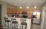 Kitchen with breakfast bar all stainless appliances