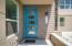 5 light blue front door and front patio of this corner townhouse