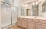 Cheerful and private master bath with oversized shower, two sinks, excellent lighting and lots of cabinets.