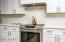 Gorgeous custom build vent hood to match the fireplaces and the modern farmhouse feel,