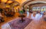 Front door foyer has a groin vaulted brick ceiling / two large custom iron palm tree design doors/ door glass opens inward for air flow and cleaning/ floor is travertine .