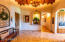 Private family garage foyer with groin vaulted wood ceiling and beautiful lighted art niche and travertine flooring/