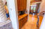 Kitchen Butlers Pantry has a Sub-Zero wine fridge and cabinets with approx. 5 drawers / 8 cabinets plus granite counter tops.