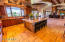 Exposed wood beams/ Lights 12 can & 2 spot / Custom Cabinet Height / Wolf Stove 6 burner plus griddle/2 ovens/ Wolf Microwave -convection/ Wolf Warming Drawer/ 2 Asko Brand dishwashers in Kitchen/ Refrigerator Sub Zero - Double Door - Fridge and Freezer / Island Granite/4 Roman Columns /Room for 6 stools/ Island sink oversized under mount commercial Stainless/ island garbage disposal / Main sink under window with amazing lake views/80-20 with low center main sink also has garbage disposal