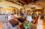 3 huge exposed wood beams/ Fireplace is gas & beautiful rock to the ceiling/ Built-in Entertainment Wall with 4 Built-in TV's that convey Built-in Rock Bar w/3 bar stoolsgranite counter top/ Bar Fridge /Built-in Speakers 6 speakers - continues thru house surround sound / Flooring in this room is travertine tile - Versailles pattern /Piano Niche fits baby grand piano .