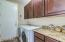 Spaceous Laundry with custom cabinets