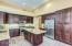 Wonderful kitchen with upgraded cabinets, lighting, pot shelves and newer appliances