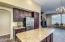 Grainite Counter tops and Island in the oversized kitchen
