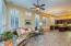 Spaceous great room area family room open to kitchen. All tiled flooring throughout and custom 4 1/2 Custom Plantation Shutters