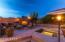 Twilight photo of spa and fireplace areas