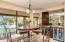 Wet bar with a wine fridge and comfortable eat-in kitchen nook looking out to the sunny backyard
