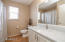 Guest bathroom with marble countertops