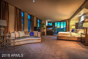 Beautiful romantic master bedroom with fireplace and fabmulous views
